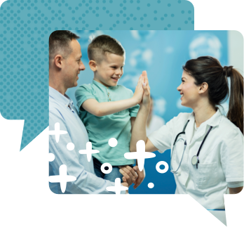 Man carrying child who is high-fiving a health care provider